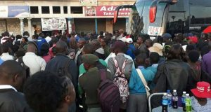 People queing at a zupco bus