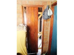 One of the damaged doors at a house raided by armed robbers in Emakhandeni suburb, Bulawayo