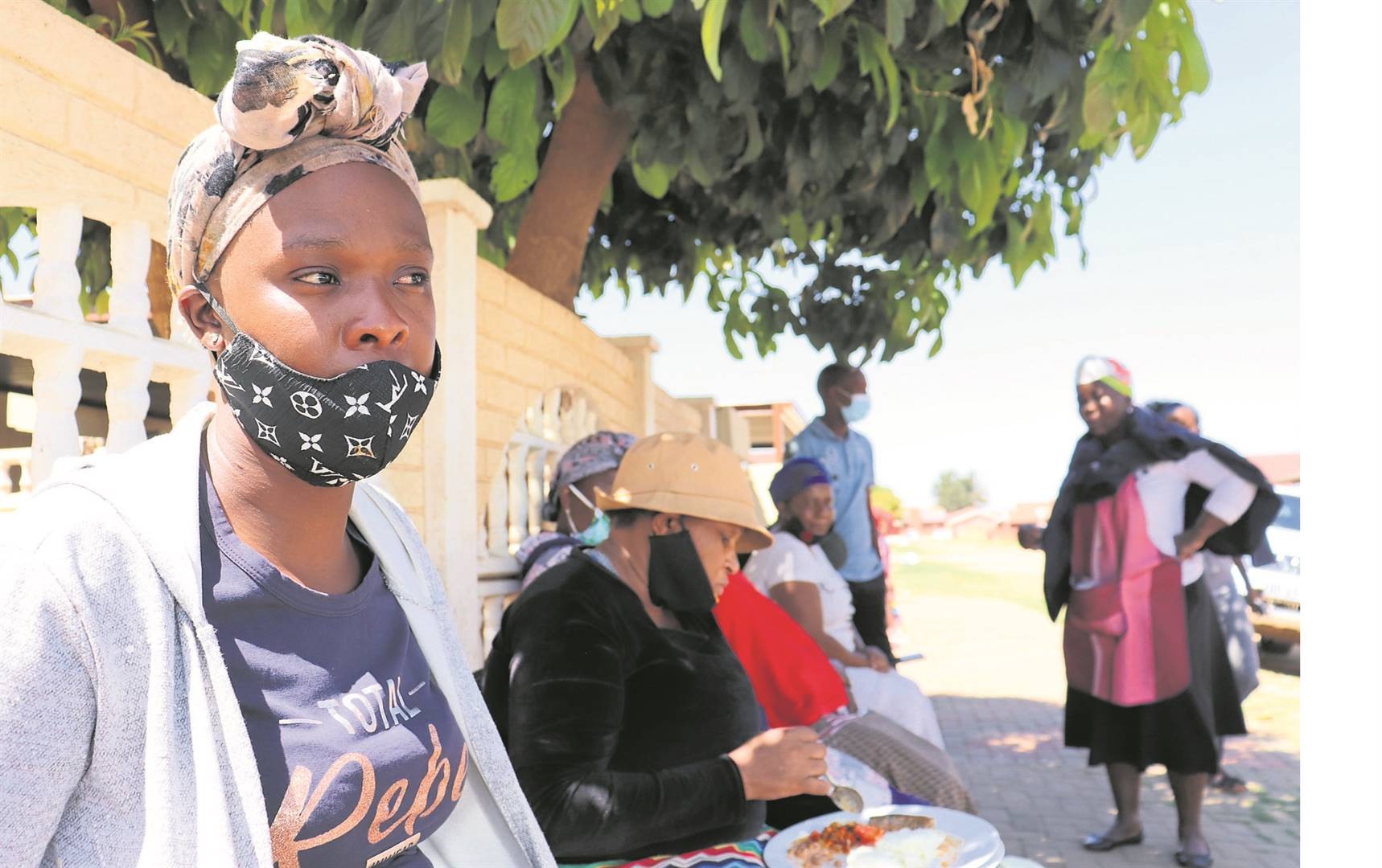 Sister Keke Mokoena at the scene with family members. Photo by Sifiso Jimta.