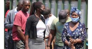 Rebecca Masawi arrives at Harare Magistrate Court in the company of her accomplices recently