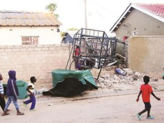 Children yesterday walk past the water tank which fell and killed nine-year-old Trinity Saungweme, together with Colleen Kamonere (18 months) and left the former's brother Thulani (two years) with a broken leg in Chitungwiza on Wednesday. — Picture: Believe Nyakudjara
