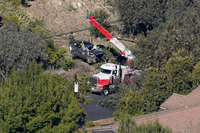 Mark J. Terrill/AP Workers move a vehicle after a rollover accident involving golfer Tiger Woods, Feb. 23, 2021, in the Rancho Palos Verdes section of Los Angeles.