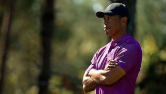 Mike Ehrmann/Getty Images, FILE Mike Ehrmann/Getty Images, FILE Tiger Woods looks on during the first round of the PNC Championship at the Ritz Carlton Golf Club, Dec. 19, 2020, in Orlando, Florida.