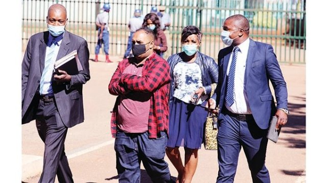Suspected cocaine dealer Guilherme Sodre Alvenaz da Silveria arrives at the Harare Magistrates Court escorted by police detectives yesterday