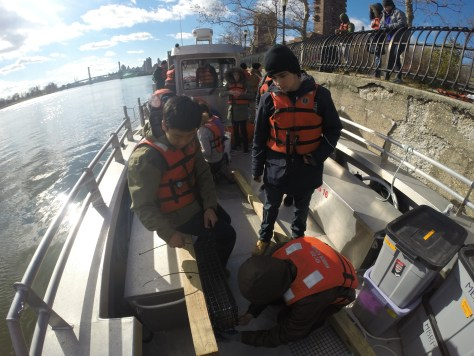 MBRP scholars deploying an experiment on the Harlem River for the Non-Profit group CIVITAS Citizens.