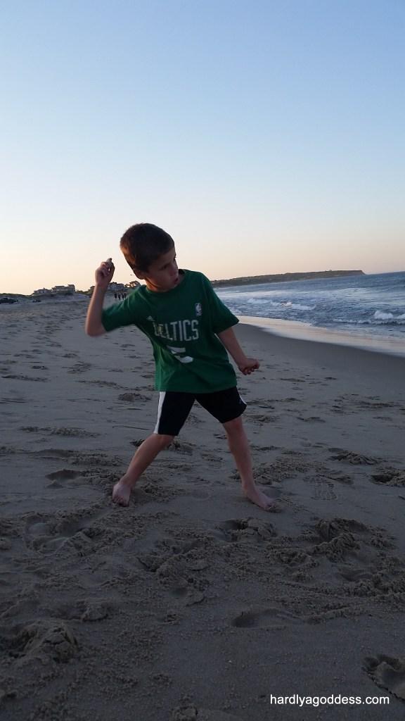 Skipping rocks at sunset