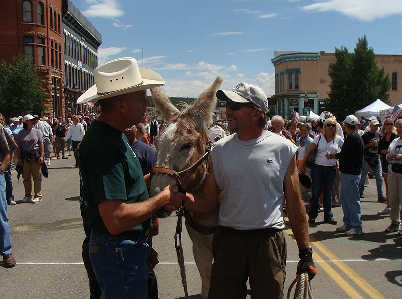 Hal Walter and his burro Laredo are congratulated by Leadville Boom Days International Pack-Burro Race director Dave TenEyck after winning the 22-mile race up and down Mosquito Pass Sunday (photo by Mary Walter).