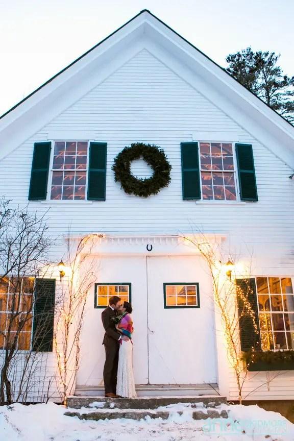 Winter wedding barn kiss at dusk