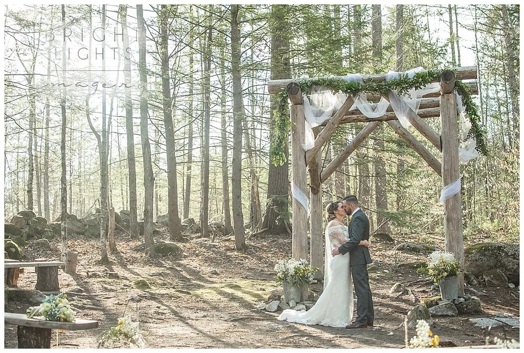 Flowers and draping at a beautiful Maine woods wedding