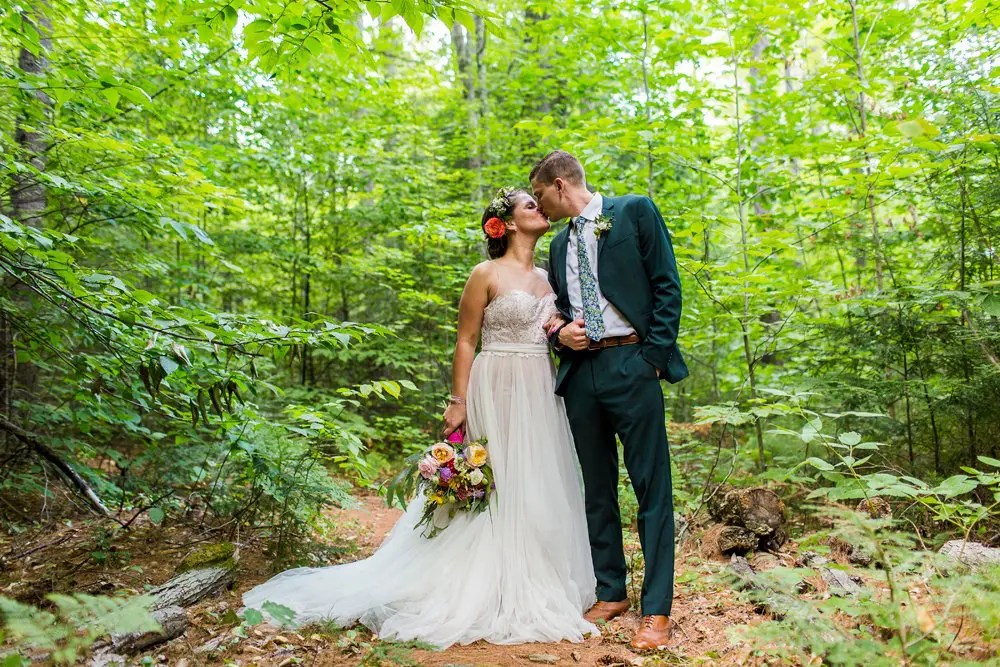 Couple wedding kiss in the woods