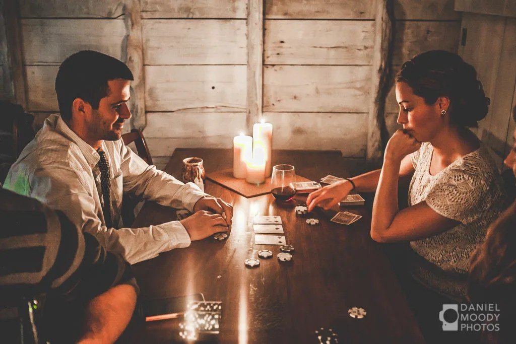 Wedding couple playing cards in barn