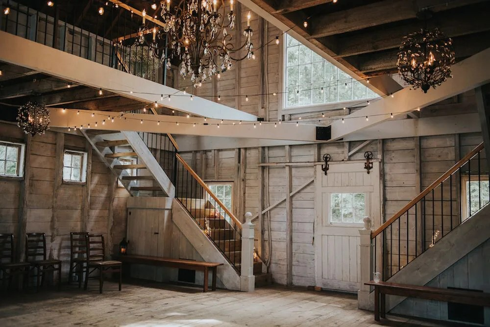 Whitewashed wedding barn with hanging lights