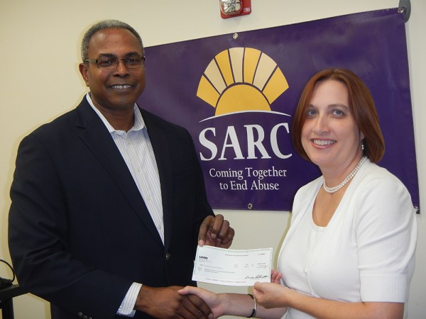 Boeing's Employees Community Fund Board Member David Lockhart, (left) presents SARC's Director of Legal Services, Gwendolyn Tate, Esq.  with a check for $5,000 to support the work of the SARC legal department on behalf of victims of domestic violence in the community.