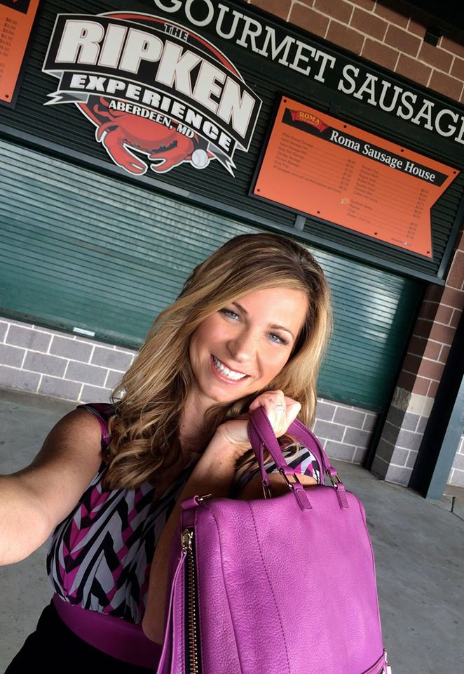 Local celebrity Tammy Ehrbaker, owner of NVS Salon, snapped a selfie of her visit to Ripken Stadium with the Traveling Purse. PHOTO CREDIT: Kelly Burns