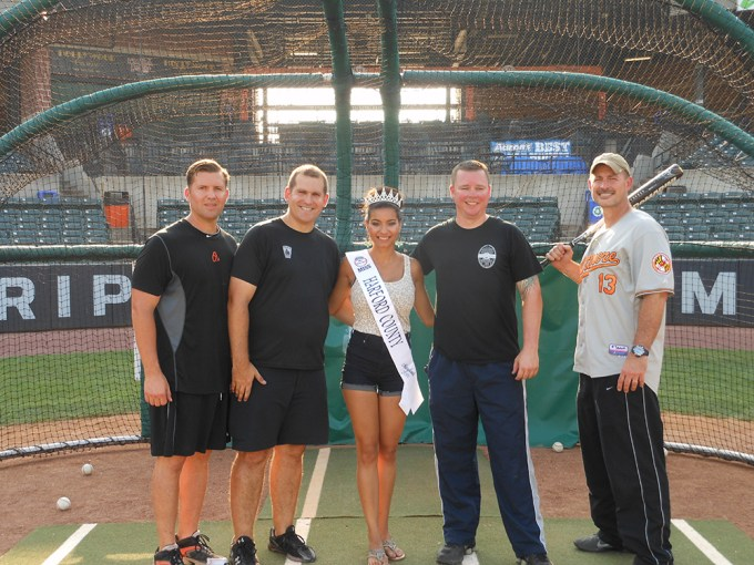 Members of the Aberdeen Police Department, who earned 1,155 points to win the Officer's Cup at this year's Home Runs for the Homeless, pose with Miss Harford County, Allison Redman. Left to right: Will Reiber, Rob Tice, Miss Harford County, Allison Redman, Paul Forsmark and Bill Garrett.