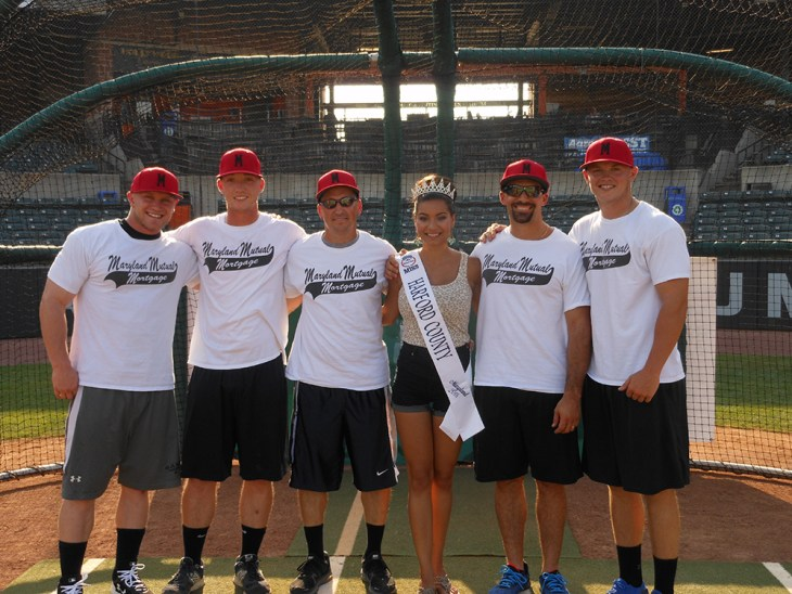 Miss Harford County, Allison Redman, poses with the champions of the home run derby, the team from Maryland Mutual Mortgage Company, who hit 12 home runs to earn 2,355 points. Left to right: Matt Wilson, Brett Hash, Mike Hughes, Miss Harford County, Allison Redman, Matt Gianni and Joe Harbach.