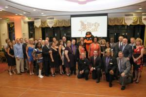 "Guests of the Harford Family House ""Bird's Ball"" were invited to wear the colors of the two best-known birds of Baltimore: the Orioles and the Ravens. The charity event was held August 29 at Water's Edge and raised $64,000."