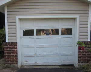 "Sheila Mulligan's old garage door was replaced by Carl's Door Service after she won the ""Messiest Garage Contest."""