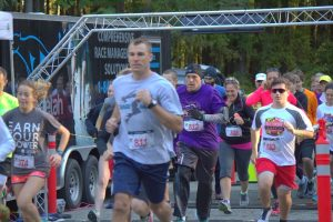 """Runners take off during the SARC's """"Holly's Hope 5K"""" in 2014. The race was started to honor a survivor of domestic violence and abuse."""