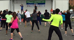 Juan Alzamora of Bel Air Armory Zumba leads a class during Healthy Harford Day 2015.