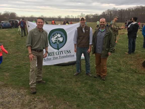 Pictured left to right, Harford County Executive Barry Glassman; Ben Lloyd, president of the Harford Land Trust Board; and Brad Killian, director of the Harford County Dept. of Planning & Zoning join volunteers planting 200 trees on Harford Land Trust property in Edgewood to celebrate Arbor Day. Harford County was named a 2015 Tree City USA by the Arbor Day Foundation in honor of its commitment to effective urban forest management.  (Photo credit: Harford County government)