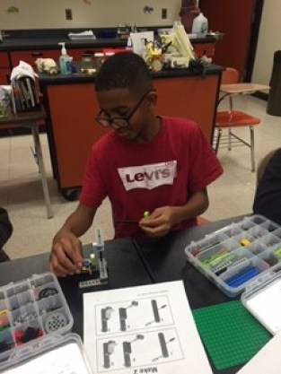 Donyell Lyons builds a motorized alligator in Bricks 4 Kids
