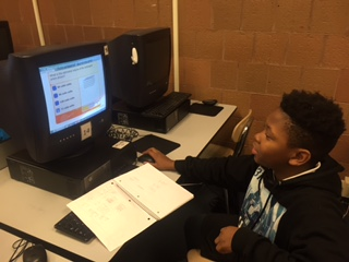 Quian Thompson practices math skills in First in Math