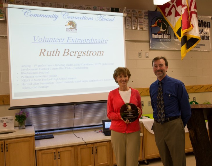 Community Connections Award recipient Ruth Bergstrom and Howard Eakes, assistant supervisor of science.