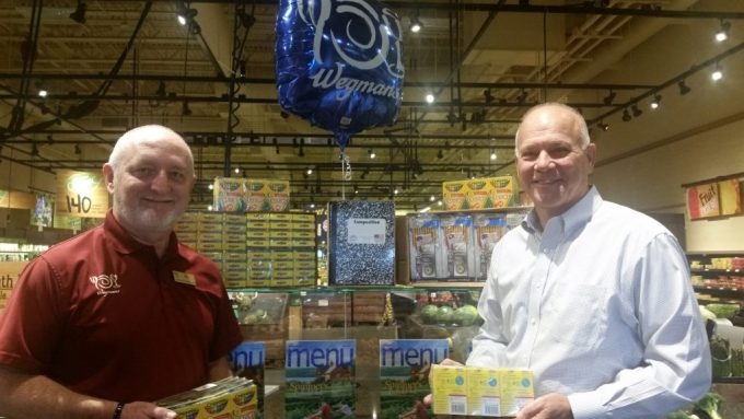 """Wegmans Supports GEEF Stuff the Bus Campaign: Al Jackson (left), manager of the Abingdon Wegmans Food Market, and Warren Hamilton, GEEF Board Chair, display some of the $2,000 worth of school supplies donated by Wegmans to support GEEF's """"Stuff the Bus"""" campaign. Donated items will be distributed to financially disadvantaged students in Harford County."""