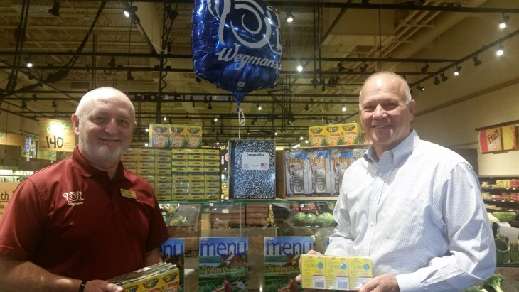 "Wegmans Supports GEEF Stuff the Bus Campaign: Al Jackson (left), manager of the Abingdon Wegmans Food Market, and Warren Hamilton, GEEF Board Chair, display some of the $2,000 worth of school supplies donated by Wegmans to support GEEF's ""Stuff the Bus"" campaign. Donated items will be distributed to financially disadvantaged students in Harford County."
