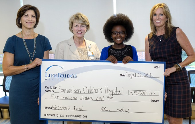 Abingdon resident Grace Callwood, founder of the We Cancerve Movement (second from right), presents a donation to Julie Cox, vice president of development for LifeBridge Health (second left) in support of a patient assistance fund to help cancer patients at Sinai Hospital. Joining the presentation are Jayne Klein, president of the Community Foundation of Harford County (left), and Brigitte Peters, the foundation's executive director. The donation was made through the We Cancerve Fund, an accumulator fund with the Community Foundation of Harford County. (Photo Courtesy of LifeBridge Health)