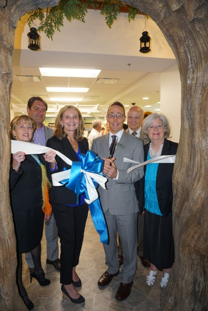 Mary Hastler, CEO of Harford County Public Library (center, left) and Alex M. Allman, chairperson of the Harford County Public Library board of trustees (center, right) participate in the September 1 ribbon cutting for the new Bel Air Library Children's Department with Bel Air Mayor Susan Burdette, Harford County Councilman Chad Shrodes, Bel Air Town Administrator Jesse Bane and Delegate Susan McComas. (Photo by Christine Sullivan)