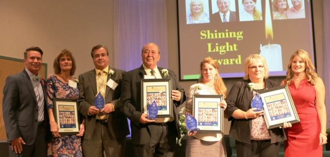 Pictured from left: County Executive Barry Glassman; Shining Light Award recipients Kim Hurd, Russ Hurd, Marvin Huntley, Wendy Messner and Denise Hanna; Director of Harford County Community Services Amber Shrodes.