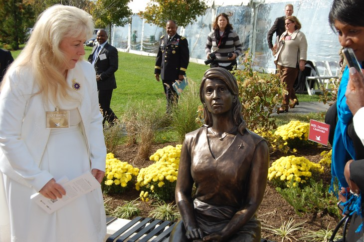 Gold Star Mother Kathryn Cross gets a closer look at the statue.