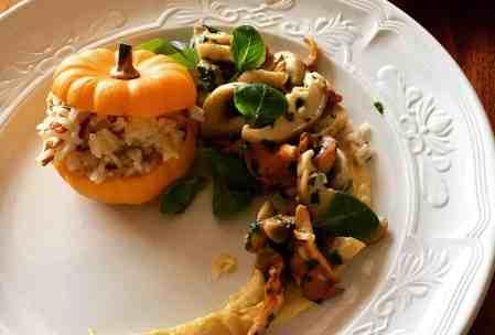 plated stuffed mini pumpkin with mushroom and puree.
