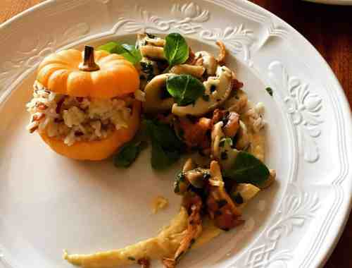 plated stuffed mini pumpkin with mushroom and puree.