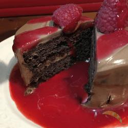 piece of chocolate fudge cake cut open