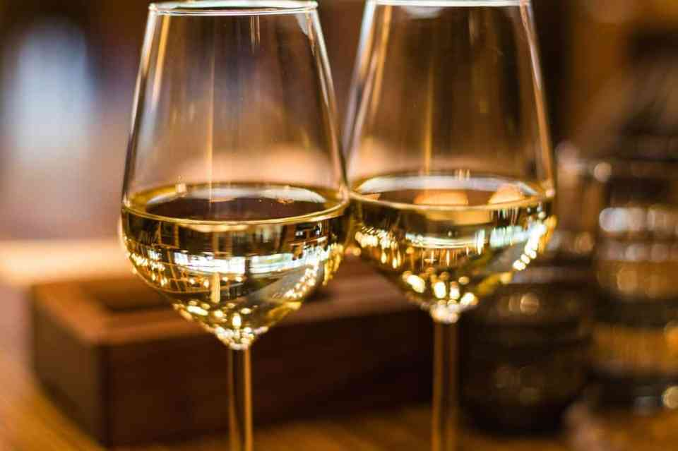 two glasses with white wine.