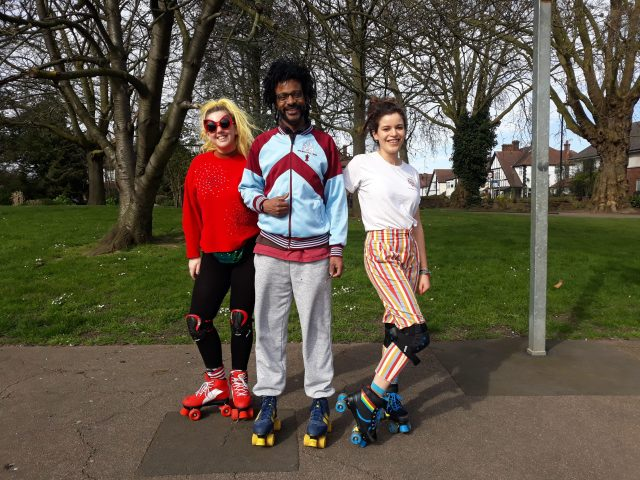 Three friends rollerskating in the park