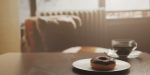 Donut with a coffee on a table