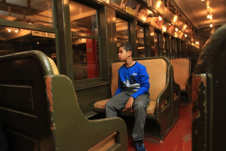Ian Aquino, 9, at the Transit Museum in Brooklyn, where he participates in the museum's Subway Sleuth program which lets kids with autism learn about trains and buses in a safe way. Brooklyn, New York, Friday, November 11, 2016. (Jesse Ward for New York Daily News)