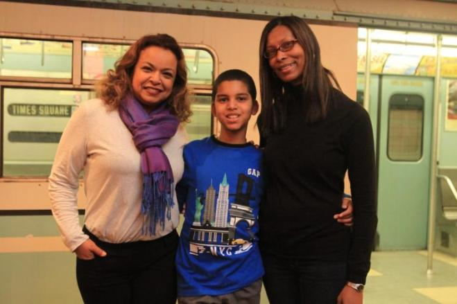 Maria Farley, 47, Ian Aquino, 9, and his mother Susana Montes, 46, at the Transit Museum in Brooklyn.