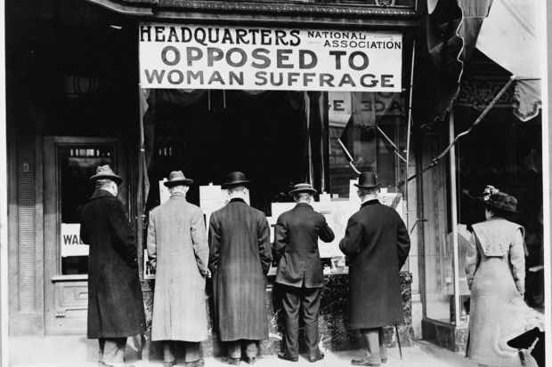 Men stand outside the National Anti-Suffrage Association headquarters around 1911.