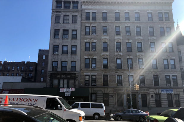 Tenants of this building are suing their landlord, claiming that the landlord illegally deregulated rent-stabilized units while receiving tax abatements form the city.