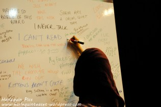 Me writing on a board full of lies.