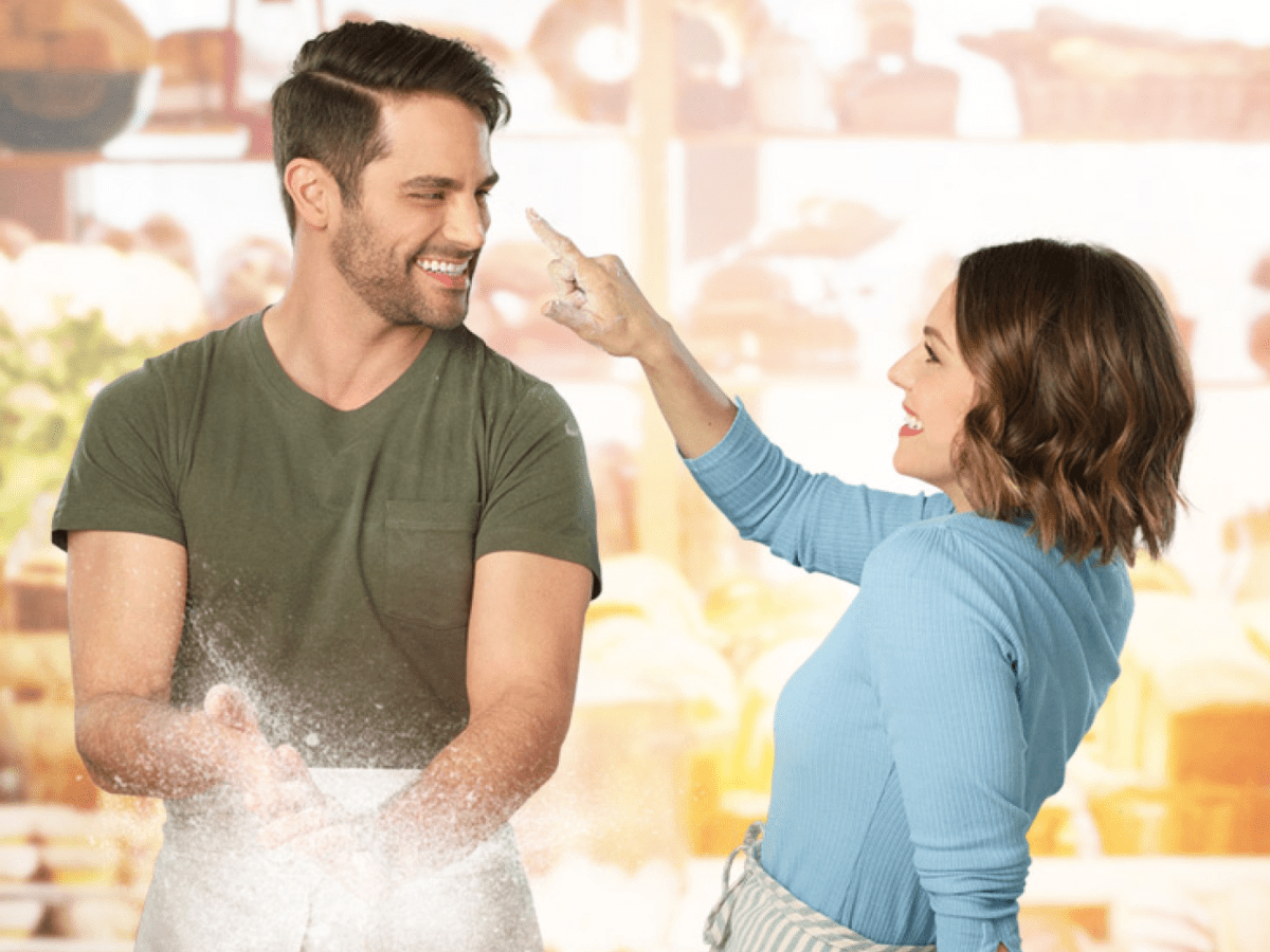 A couple is playful while baking