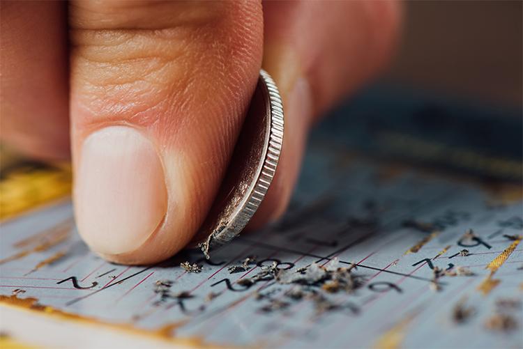 close up of scratch card, 5p coin