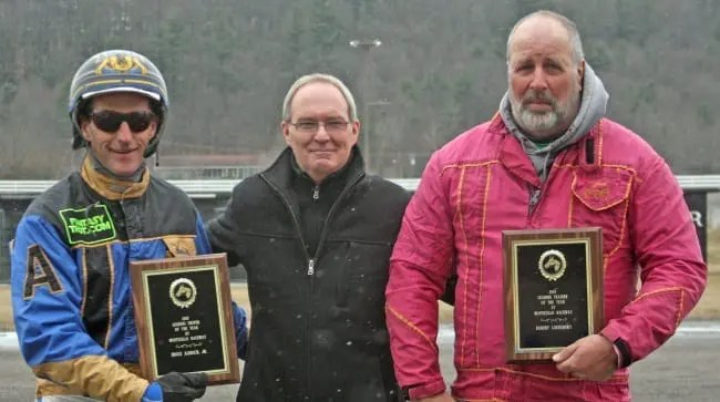 Bob Lounsbury (right) and his chief Monticello driver Bruce Aldrich, Jr. accepting the awards as Monticello's leading trainer and driver, respectively.