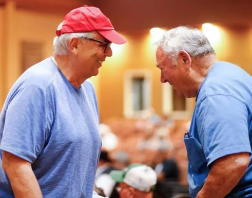 Dave Landry   Marvin Katz (left) congratulates breeder Harry Rutherford after purchasing the latter's Kadabra filly for $300,000 to top Thursday's session at Fasig-Tipton.