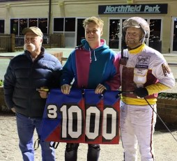 Raymond Lance | Arron Merriman (right), with his son Kris (center) and father Lanny in the Northfield Park winner's circle Monday (Dec. 30) after win 1,000 in 2019. It is the third straight year Merriman has recorded 1,000 or more wins in a season.